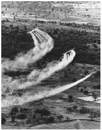U.S. Air Force planes spray Agent Orange over the South Vietnamese countryside in 1966. (Reproduced by permission of AP/Wide World Photos.)