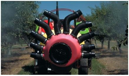 An orchard sprayer killing pests in fruit trees. (Reproduced by permission of Phototake.)