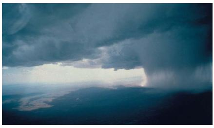 Cold fronts are usually accompanied by cumulonimbus thunderstorm clouds. (Reproduced by permission of National Center for Atmospheric Research.)