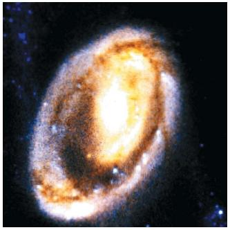 The Hubble Space Telescope (HST) captured this image of the Cartwheel galaxy. Large space-based observatories, such as the HST, lead to major advances in astrophysics by exploring unknown parts of the universe. (Reproduced by permission of the National Aeronautics and Space Administration.)