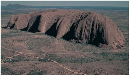 Uluru (Ayers Rock) in central Australia measures 1,143 feet (349 meters) high. (Reproduced by permission of JLM Visuals.)