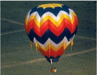 Hot-air balloon over Albuquerque, New Mexico. (Reproduced by permission of Phototake.)