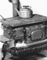 The energy generated by the burning wood in this stove puts forth heat used to cook food and heat the home. (Reproduced by permission of Corbis-Bettmann.)