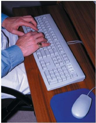 Continuous typing on a keyboard can cause carpal tunnel syndrome. (Reproduced by permission of Field Mark Publications.)
