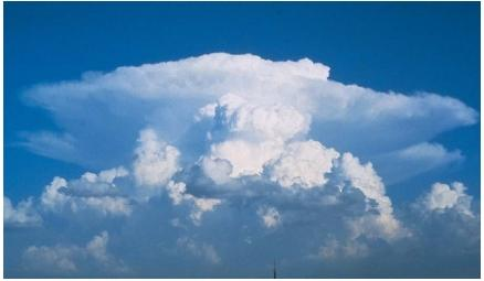 Cumulonimbus clouds. (Reproduced by permission of Walter A. Lyons.)