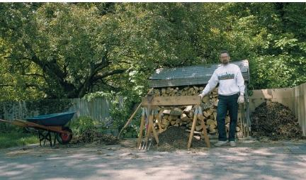 Backyard composting in Livonia, Michigan. This system includes a composting bin made from chicken wire and plywood, a soil screen made from mesh wire and wood boards, a wheelbarrow, and a digging fork. (Reproduced by permission of Field Mark Publications.)