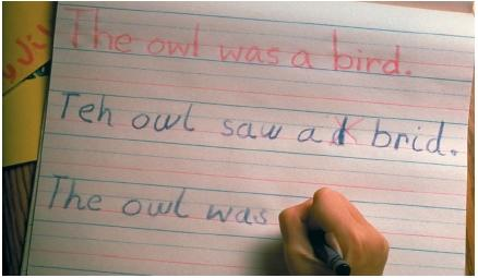 A student with dyslexia has difficulty copying words. (Reproduced by permission of Photo Researchers, Inc.)