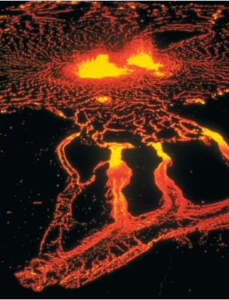 Molten lava from the Hawaiian volcano Kilauea. (Reproduced by permission of JLM Visuals.)
