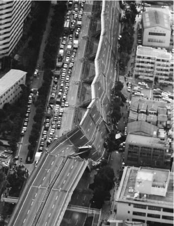 A portion of the Hanshin Expressway is twisted down on its side in Nishinomiya after a powerful earthquake rocked the western Japanese city on January 17, 1995. The highway runs from Osaka to Kobe, a port city. Thousands were injured and 1,300 killed. (Reproduced by permission of AP/Wide World Photos.)