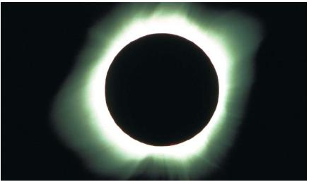 A total solar eclipse in La Paz, Baja California, Mexico, on July 11, 1991. (Reproduced by permission of Photo Researchers, Inc.)