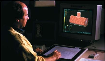 Engineer in Geneva, Switzerland, using computer-aided design (CAD) software to design a pipe junction. (Reproduced by permission of Photo Researchers, Inc.)
