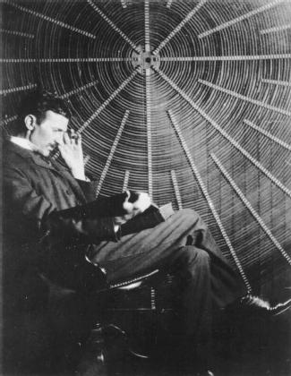 Serbian-born American electrical engineer Nikola Tesla (1856–1943) with one of his early electrical generators. (Reproduced by permission of The Granger Collection, Ltd.)