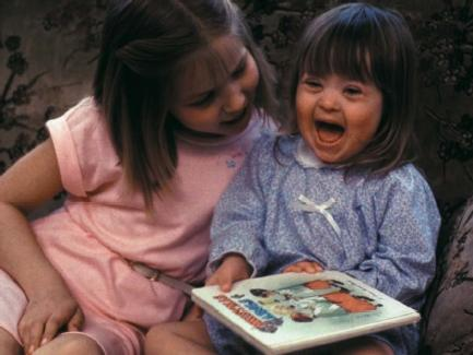 A young girl with the genetic disorder Down syndrome. (Reproduced by permission of Photo Researchers, Inc.)