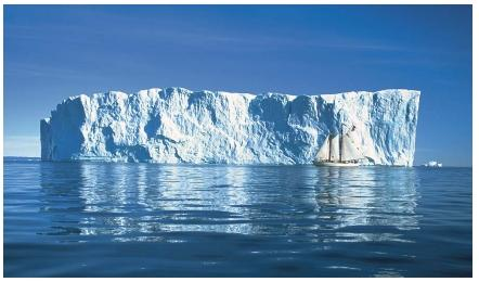 An iceberg in Disko Bay on the western coast of Greenland. (Reproduced by permission of The Stock Market.)