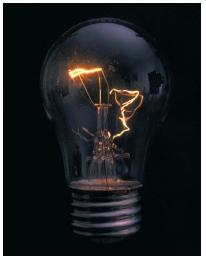 An incandescent lightbulb. (Reproduced by permission of Phototake.)