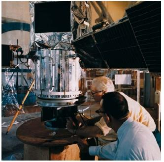 Technicians looking over the International Ultraviolet Explorer during magnetic checks, at Goddard Space Flight Center. (Reproduced by permission of The Corbis Corporation.)
