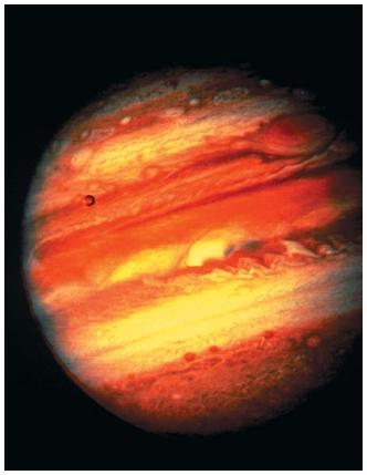 Jupiter, as seen by Voyager 1. The planet is the most massive object in the solar system after the Sun; its mass is greater than that of all the other planets combined. (Reproduced by permission of National Aeronautics and Space Administration.)