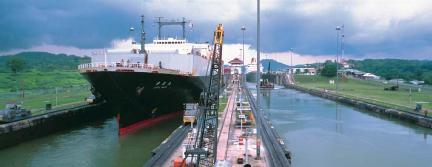 Ships in the Miraflores locks on the Panama Canal. (Reproduced by permission of Photo Researchers, Inc.)