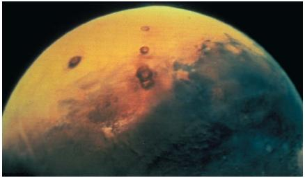 Mars, as seen from space by Viking 1. The planet is slightly more than one-tenth as massive as Earth. (Reproduced by permission of National Aeronautics and Space Administration.)