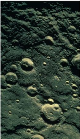 On Mercury, the plains between craters, such as these located near the planet's south pole, are crossed by numerous ridges and cliffs that are similar in scale to those on Earth. (Reproduced by permission of National Aeronautics and Space Administration.)
