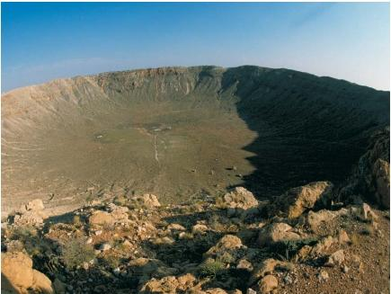 Barringer Crater, an astrobleme in northern Arizona that measures 0.7 miles (1.2 kilometers) across and 590 feet (180 meters) deep. It is believed to have been created about 25,000 years ago by a meteorite about the size of a large house traveling at 9 miles (15 kilometers) per second. (Reproduced by permission of The Corbis Corporation [Bellevue].)