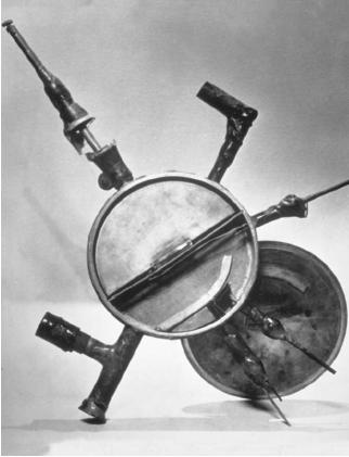 The first successful cyclotron, built in 1930 by Ernest Lawrence at the University of California at Berkeley. Only 4.5 inches (12 centimeters) in diameter, it accelerated protons to 80,000 volts. (Reproduced by permission of Photo Researchers, Inc.)