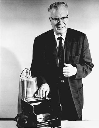 Chester Carlson demonstrating the first Xerox photocopier. (Reproduced by permission of the Corbis Corporation [Bellevue].)