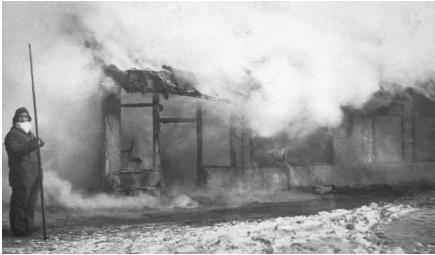 Burning of houses during the last worldwide outbreak of the plague in the 1890s. The disease spread from China westward along trade routes. (Reproduced by permission of Photo Researchers, Inc.)