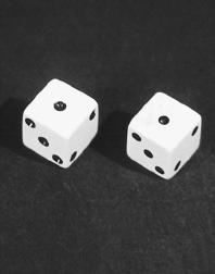 The probability of rolling snake eyes (two ones) with a pair of dice is 1 in 36. (Reproduced by permission of Field Mark Publications.)