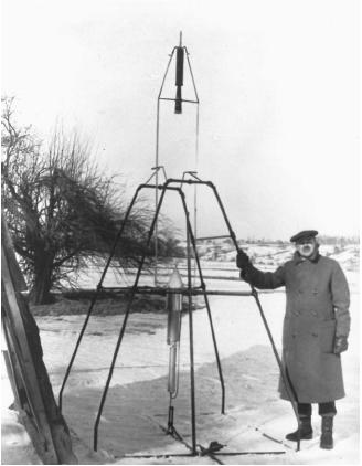 Robert H. Goddard beside the first rocket to successfully use liquid fuel. It flew on March 16, 1926, at Auburn, Massachusetts. (Reproduced by permission of National Aeronautics and Space Administration.)