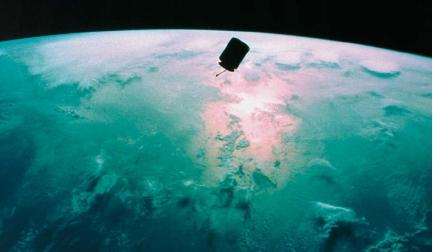 Intelsat VI floating over the Earth. (Reproduced by permission of National Aeronautics and Space Administration.)