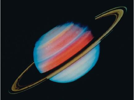 Saturn, the second largest planet in the solar system, and its system of rings. (Reproduced by permission of National Aeronautics and Space Administration.)
