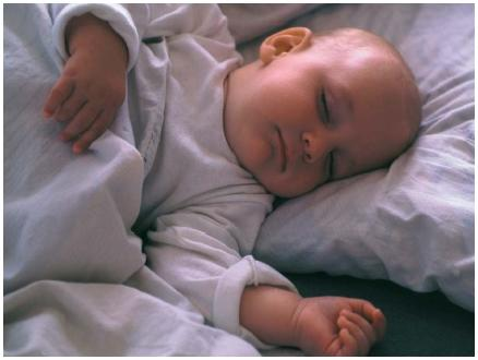 Scientific studies are still inconclusive as to whether it's better to have young babies sleep on their back or on their side. (Reproduced by permission of Photo Researchers, Inc.)