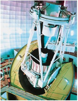 The Anglo-Australian telescope (AAT) in New South Wales, Australia. AAT was one of the first electronically controlled telescopes. (Reproduced by permission of Photo Researchers, Inc.)