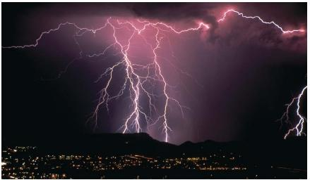 Lightning over Tucson, Arizona. (Reproduced by permission of Photo Researchers, Inc.)