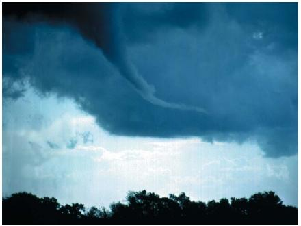 Approaching tornado with distinctive funnel. (Reproduced by permission of Photo Researchers, Inc.)