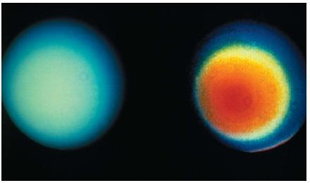 Unlike other gas giants, Uranus doesn't reveal many atmospheric features in visible light. However, latitudinal (side-to-side) atmospheric bands do exist, as can be seen in the enhanced image on the right. Because Uranus rotates nearly on its side, atmospheric bands that cross the planet's surface appear as concentric circles in the photo. (Reproduced by permission of National Aeronautics and Space Administration.)