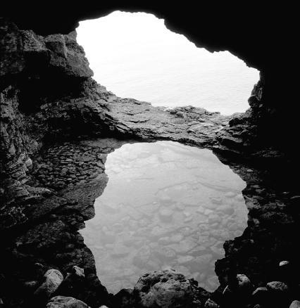 A cave forming by a sea.